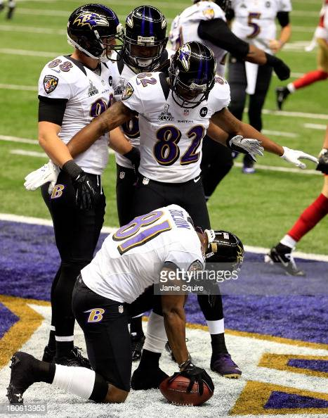Anquan Boldin of the Baltimore Ravens celebrates with teammates Dennis Pitta and Torrey Smith after scoring a touchdown in the first quarter against...