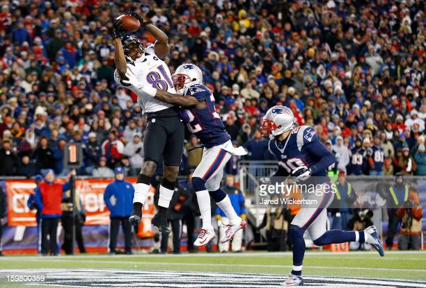 Anquan Boldin of the Baltimore Ravens scores a touchdown passed by Joe Flacco in the fourth quarter against Devin McCourty of the New England...