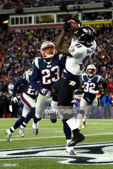 Anquan Boldin of the Baltimore Ravens scores his second touchdown pass by Joe Flacco in the fourth quarter against Marquice Cole of the New England...