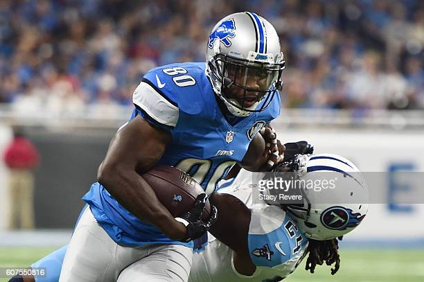 Anquan Boldin of the Detroit Lions avoids a tackle by Daimion Stafford of the Tennessee Titans during the first half of a game at Ford Field on...