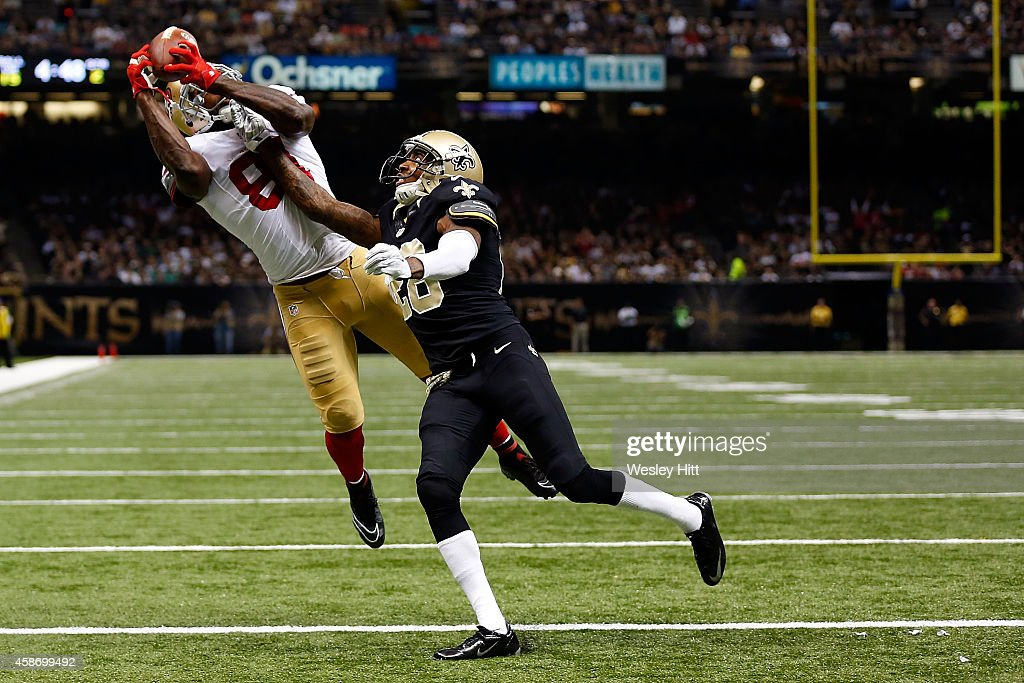 <a gi-track='captionPersonalityLinkClicked' href=/galleries/search?phrase=Anquan+Boldin&family=editorial&specificpeople=182484 ng-click='$event.stopPropagation()'>Anquan Boldin</a> #81 of the San Francisco 49ers catches a touchdown pass in front of <a gi-track='captionPersonalityLinkClicked' href=/galleries/search?phrase=Keenan+Lewis&family=editorial&specificpeople=2167460 ng-click='$event.stopPropagation()'>Keenan Lewis</a> #28 of the New Orleans Saints during the second quarter of a game at the Mercedes-Benz Superdome on November 9, 2014 in New Orleans, Louisiana.