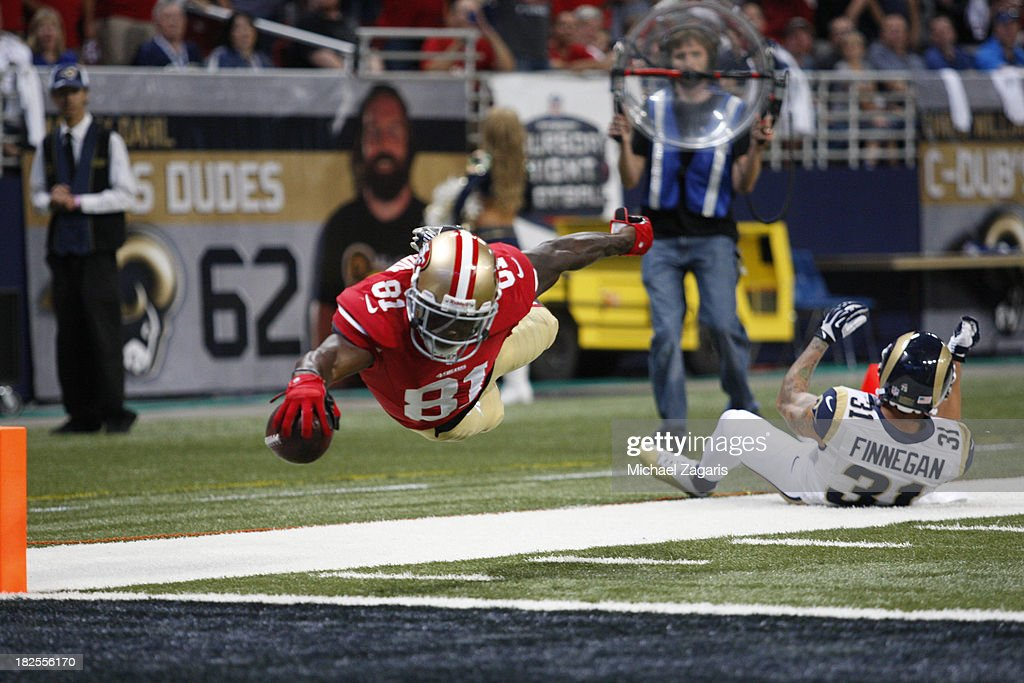 <a gi-track='captionPersonalityLinkClicked' href=/galleries/search?phrase=Anquan+Boldin&family=editorial&specificpeople=182484 ng-click='$event.stopPropagation()'>Anquan Boldin</a> #81 of the San Francisco 49ers dives into the end zone on a 20-yard touchdown reception during the game against the St. Louis Rams at the Edward Jones Dome on September 26, 2013 in St. Louis, Missouri. The 49ers defeated the Rams 35-11.