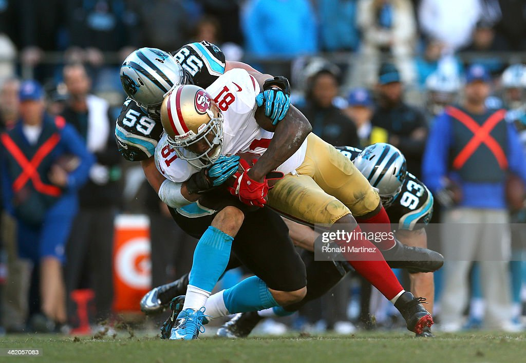 Anquan Boldin of the San Francisco 49ers is tackled after a catch by Luke Kuechly and Chase Blackburn of the Carolina Panthers in the fourth quarter...