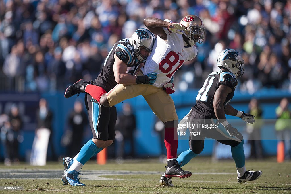 Anquan Boldin #81 of the San Francisco 49ers is tackled by a Carolina Panther during the NFC Divisional Playoff Game between the two teams at Bank of America Stadium on January 12, 2014 in Charlotte, North Carolina.