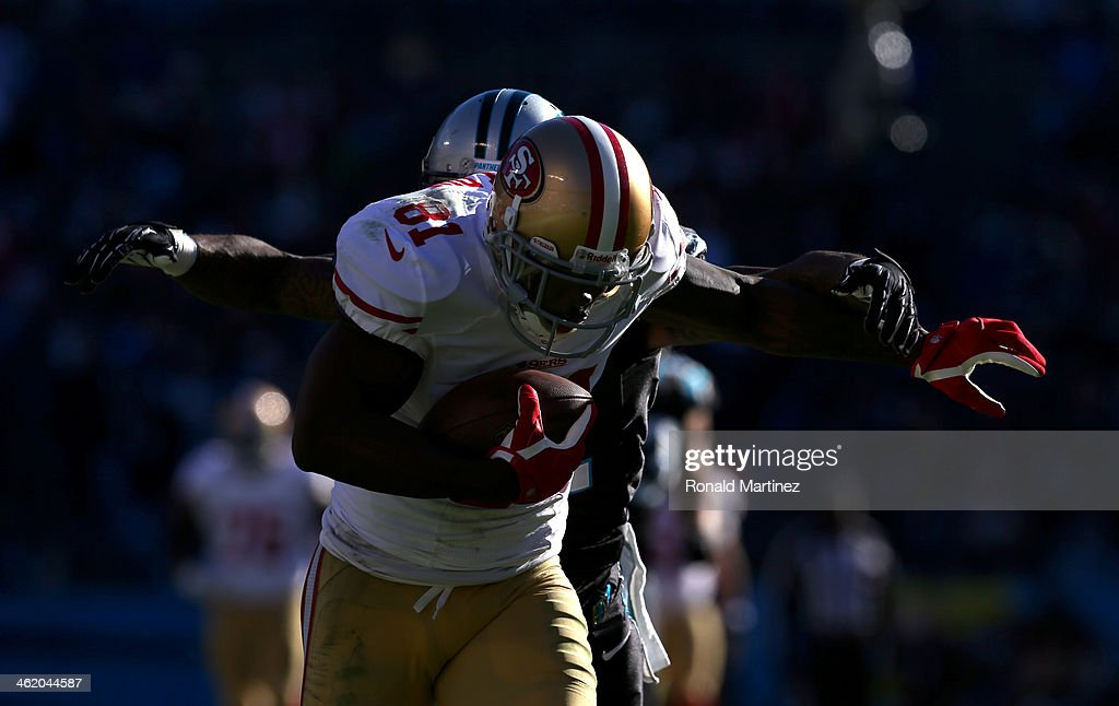 <a gi-track='captionPersonalityLinkClicked' href=/galleries/search?phrase=Anquan+Boldin&family=editorial&specificpeople=182484 ng-click='$event.stopPropagation()'>Anquan Boldin</a> #81 of the San Francisco 49ers runs after a catch against <a gi-track='captionPersonalityLinkClicked' href=/galleries/search?phrase=Captain+Munnerlyn&family=editorial&specificpeople=4063410 ng-click='$event.stopPropagation()'>Captain Munnerlyn</a> #41 of the Carolina Panthers in the third quarter during the NFC Divisional Playoff Game at Bank of America Stadium on January 12, 2014 in Charlotte, North Carolina.