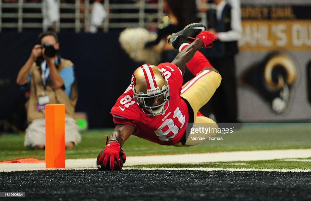 <a gi-track='captionPersonalityLinkClicked' href=/galleries/search?phrase=Anquan+Boldin&family=editorial&specificpeople=182484 ng-click='$event.stopPropagation()'>Anquan Boldin</a> #81 of the San Francisco 49ers scores a touchdown against the St. Louis Rams at the Edward Jones Dome on September 26, 2013 in St. Louis, Missouri.