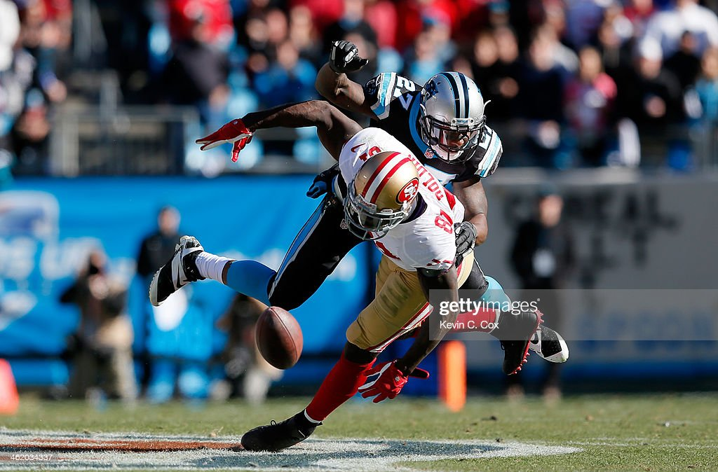 <a gi-track='captionPersonalityLinkClicked' href=/galleries/search?phrase=Anquan+Boldin&family=editorial&specificpeople=182484 ng-click='$event.stopPropagation()'>Anquan Boldin</a> #81 of the San Francisco 49ers tries to make a catch against <a gi-track='captionPersonalityLinkClicked' href=/galleries/search?phrase=Quintin+Mikell&family=editorial&specificpeople=763498 ng-click='$event.stopPropagation()'>Quintin Mikell</a> #27 of the Carolina Panthers in the second quarter during the NFC Divisional Playoff Game at Bank of America Stadium on January 12, 2014 in Charlotte, North Carolina.
