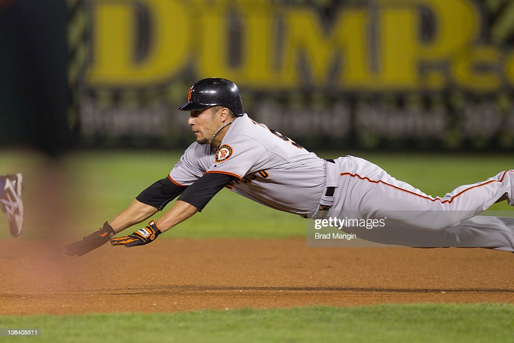 Anres Torres of the San Francisco Giants steals second base in the top of the first inning of Game Four of the 2010 World Series against the Texas...