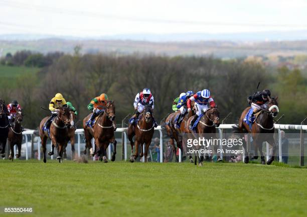 Ansaab and Silvestre De Sousa just beats Stellar Express and Andrew Mullen to win the Full Ponte Package New for 2014 Handicap at Pontefract...