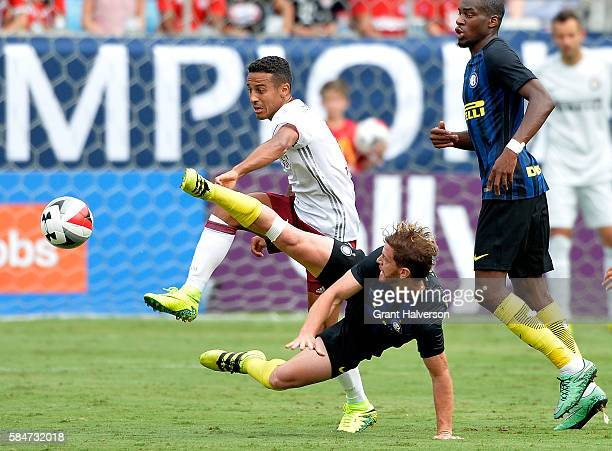 C Ansaldi of FC Internazionale knocks the ball away from Timothy Tillman of FC Bayern Munich during an International Champions Cup match at Bank of...
