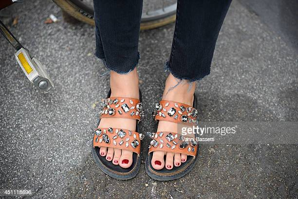 Ansar Bibirakhmetoba is seen wearing a Helmut Lang pants and Zara shoes before Etro show on June 23 2014 in Milan Italy