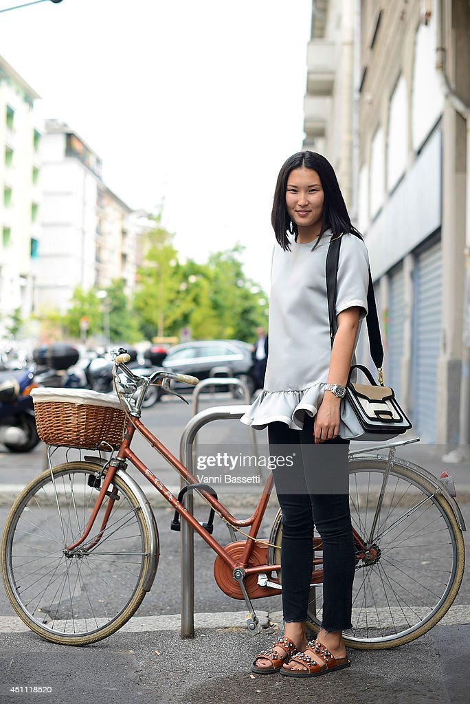 Ansar Bibirakhmetoba is seen wearing a Marc Jacobs top, Helmut Lang pants, Pierre Hardy bag and Zara shoes before Etro show on June 23, 2014 in Milan, Italy.