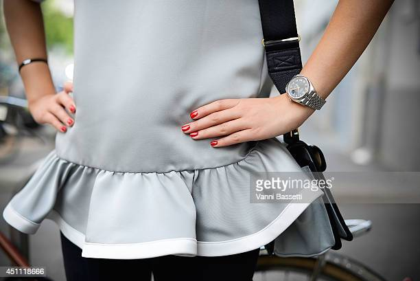 Ansar Bibirakhmetoba is seen wearing a Marc Jacobs top Helmut Lang pants Pierre Hardy bag and a Rolex watch before Etro show on June 23 2014 in Milan...