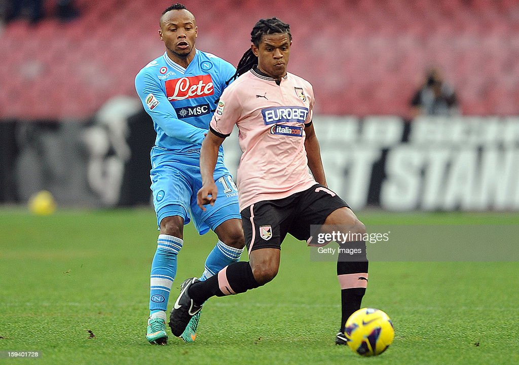 Anselmo de Moraes of Palermo is challenged by Juan Camilo Zuniga of Napoli (L) during the Serie A match between SSC Napoli and US Citta di Palermo at Stadio San Paolo on January 13, 2013 in Naples, Italy.