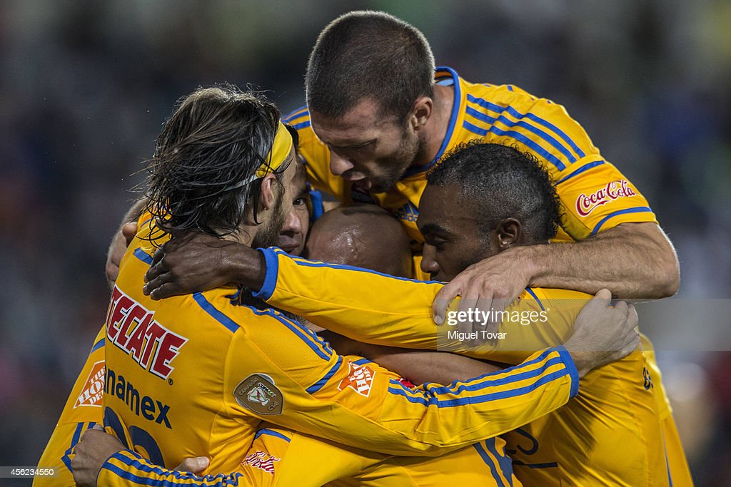 Anselmo Junior of Tigres celebrates with teammates after scoring the goal of Victory during a match between Pachuca v Tigres UANL as part of 10th...