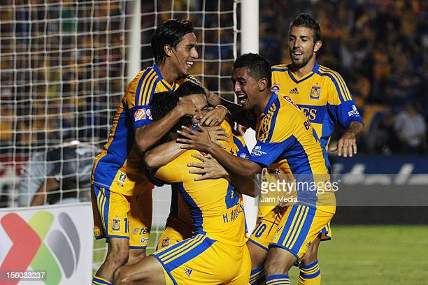 Anselmo Vendrechovski Hugo Ayala Elias Hernan Hernandez and Lucas Lobos of Tigres celebrate a scored goal against America during a match between...