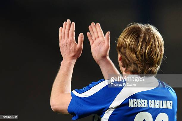 Ansgar Brinkmann applauds during the Ansgar Brinkmann Farewell Match at the Schueco Arena on March 27 2009 in Bielefeld Germany