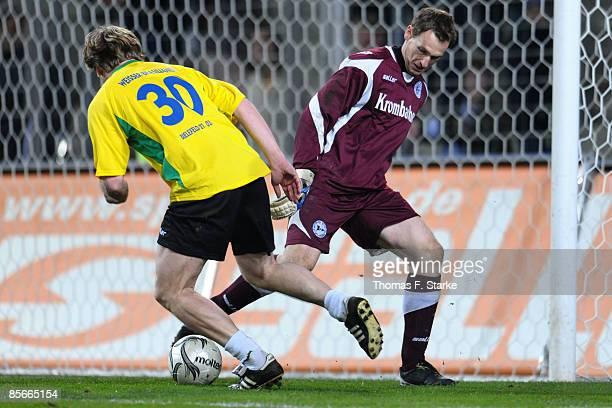 Ansgar Brinkmann Mathias Hain tackle for the ball during the Ansgar Brinkmann Farewell Match at the Schueco Arena on March 27 2009 in Bielefeld...