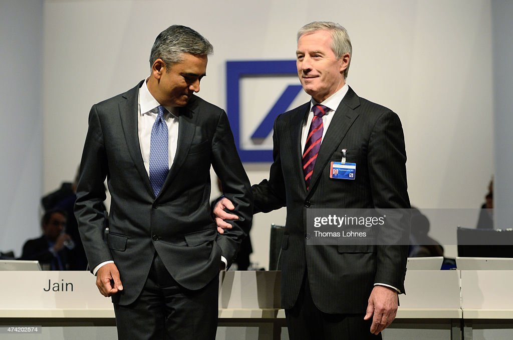 Anshu Jain (L) and Juergen Fitschen (R), co-CEO of the Deutsche Bank pose for the beginning of the company's annual shareholder meeting on May 21, 2015 in Frankfurt am Main, Germany.