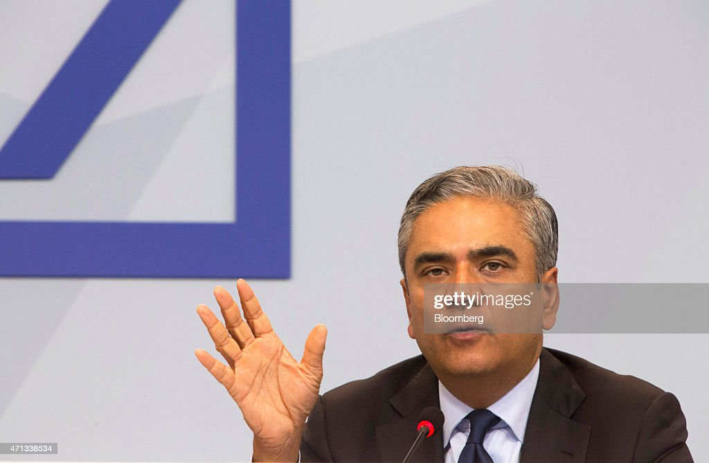 <a gi-track='captionPersonalityLinkClicked' href=/galleries/search?phrase=Anshu+Jain&family=editorial&specificpeople=4132683 ng-click='$event.stopPropagation()'>Anshu Jain</a>, co-chief executive officer of Deutsche Bank AG, gestures during a news conference in Frankfurt, Germany, on Monday, April. 27, 2015. Deutsche Bank AG plans to reduce annual costs by a further 3.5 billion euros ($3.8 billion), cut back its ownership in the Postbank consumer unit and shrink the securities business to revive profitability. Photographer: Martin Leissl/Bloomberg via Getty Images