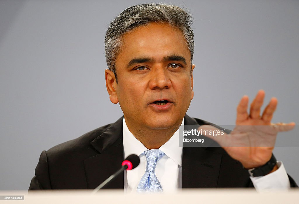 Anshu Jain, co-chief executive officer of Deutsche Bank AG, gestures as he speaks during a news conference to announce the bank's results at their headquarters in Frankfurt, Germany, on Wednesday, Jan. 29, 2014. Deutsche Bank AG, Germany's biggest bank, cut total compensation for employees at its investment bank 23 percent in the fourth quarter as a slide in revenue contributed to a loss for the period. Photographer: Ralph Orlowski/Bloomberg via Getty Images