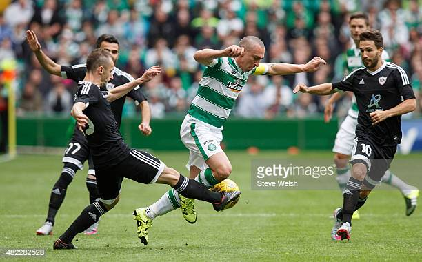 Ansi Agolli of FK Qarabag tackles Scott Brown of Celtic during the UEFA Champions League Third Qualifying Round 1st Leg match between Celtic and FK...