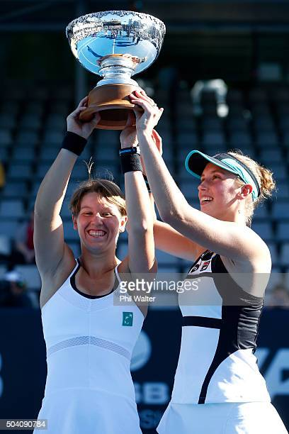 AnSophie Mestach and Elise Mertens of Belguim celebrate with the doubles trophy after defeating Danka Kovinic and Barbora Strycova in the doubles...