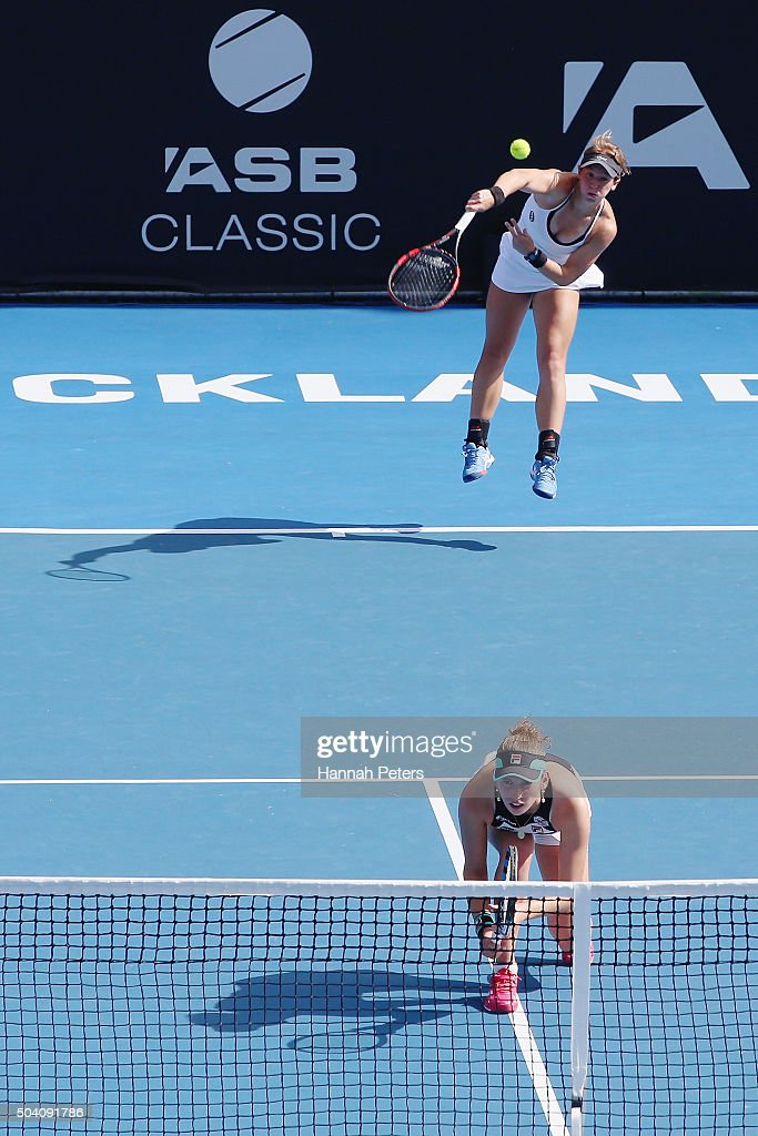 An-Sophie Mestach Ansophie-mestach-serves-over-the-top-of-partner-elise-mertens-of-picture-id504091786