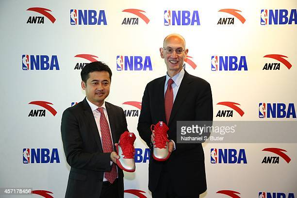 Anta Chairman and CEO Ding ShiZhong and NBA Commissioner Adam Silver pose for a photo at the Anta press conference as part of the 2014 NBA Global...