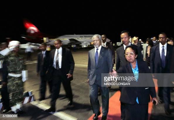 UN Secretary General Kofi Annan is escorted 15 March 2006 by his security guards and Malgashi protocol officials upon his arrival in Antananarivo...
