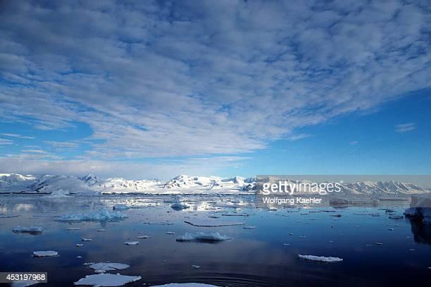 Antarctic Peninsula Area Mountains And Ice Evening Light