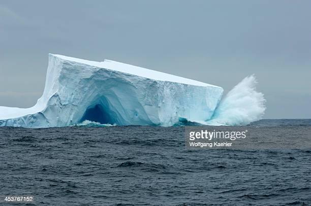 Antarctica Scotia Sea Near South Georgia Waves Crashing On Tabular Iceberg With Cave