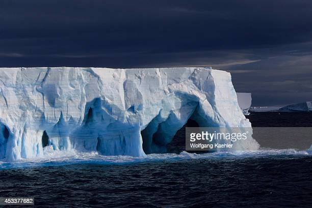 Antarctica Tabular Iceberg With Caves Arches