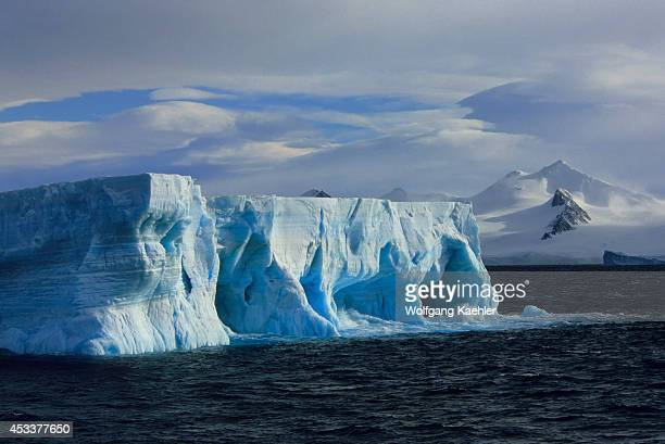 Antarcticatabular Iceberg With Caves Arches Mt Bransfield Antarctic Peninsula Background