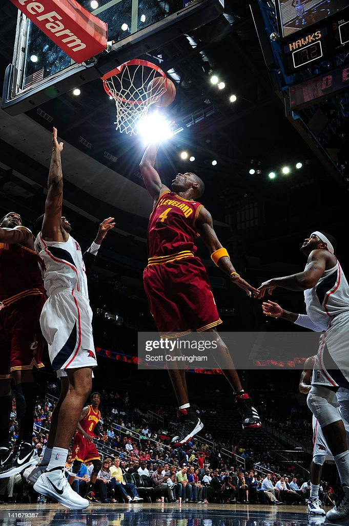 Antawn Jamison #4 of the Cleveland Cavaliers goes to the basket during the game between the Atlanta Hawks and the Cleveland Cavaliers on March 21, 2012 at Philips Arena in Atlanta, Georgia.