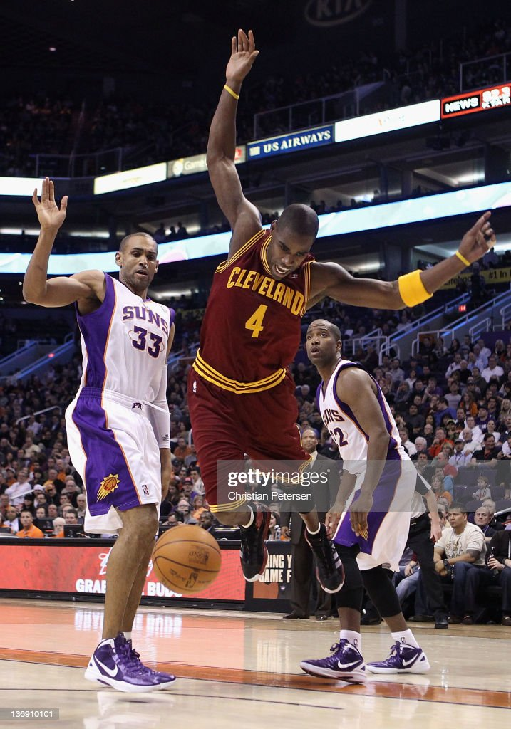 <a gi-track='captionPersonalityLinkClicked' href=/galleries/search?phrase=Antawn+Jamison&family=editorial&specificpeople=201670 ng-click='$event.stopPropagation()'>Antawn Jamison</a> #4 of the Cleveland Cavaliers loses the ball as he drives past <a gi-track='captionPersonalityLinkClicked' href=/galleries/search?phrase=Grant+Hill+-+Basketball+Player&family=editorial&specificpeople=201658 ng-click='$event.stopPropagation()'>Grant Hill</a> #33 and <a gi-track='captionPersonalityLinkClicked' href=/galleries/search?phrase=Michael+Redd&family=editorial&specificpeople=201789 ng-click='$event.stopPropagation()'>Michael Redd</a> #22 of the Phoenix Suns during the NBA game at US Airways Center on January 12, 2012 in Phoenix, Arizona.