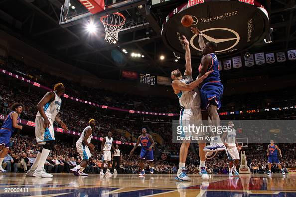 Antawn Jamison of the Cleveland Cavaliers shoots over Peja Stojakovic of the New Orleans Hornets on February 23 2010 at The Quicken Loans Arena in...