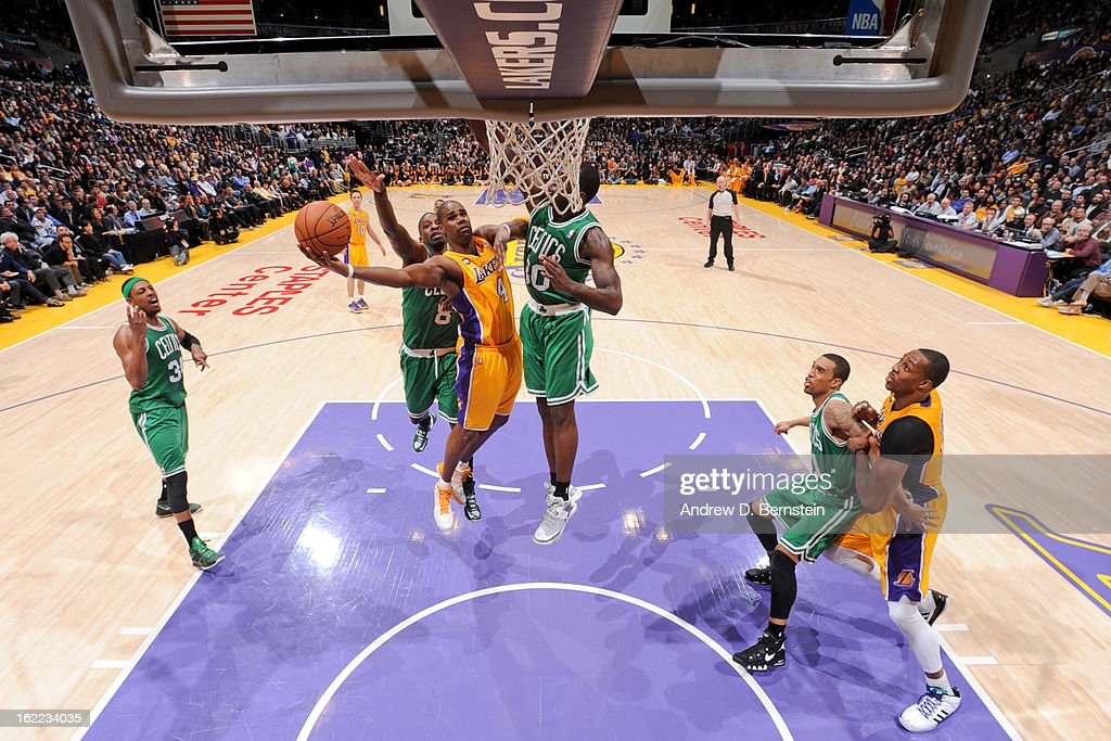 Antawn Jamison #4 of the Los Angeles Lakers attempts a layup against Jeff Green #8 and Brandon Bass #30 of the Boston Celtics at Staples Center on February 20, 2013 in Los Angeles, California.