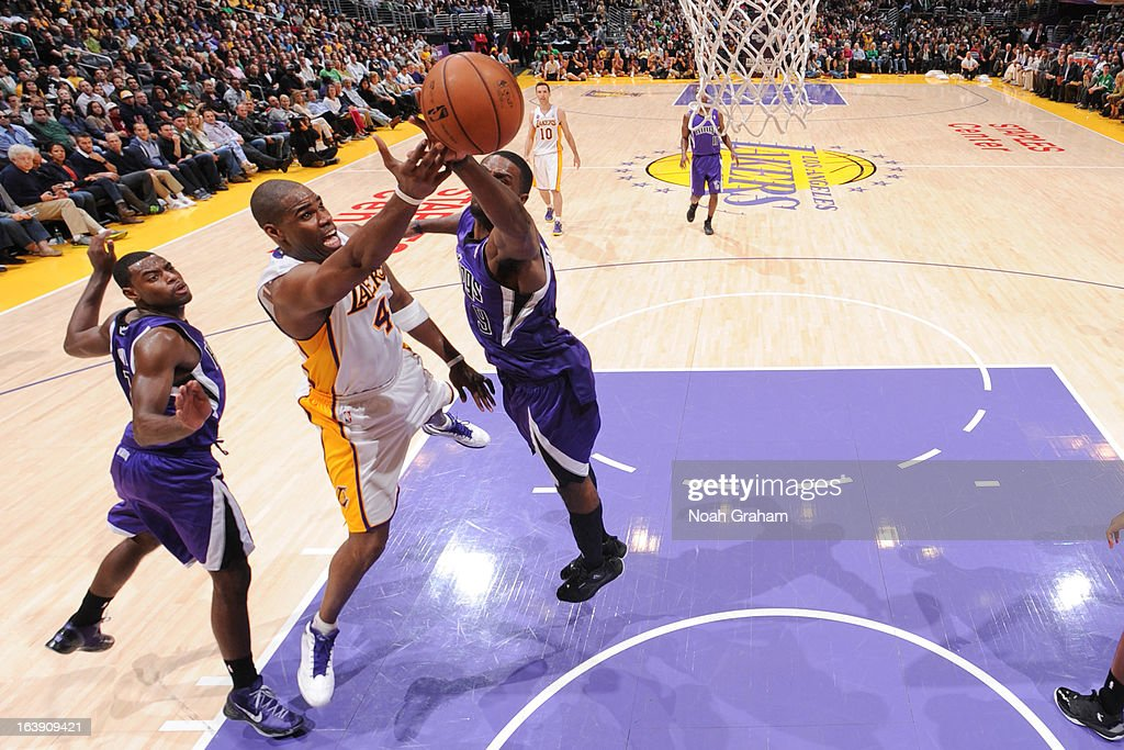 <a gi-track='captionPersonalityLinkClicked' href=/galleries/search?phrase=Antawn+Jamison&family=editorial&specificpeople=201670 ng-click='$event.stopPropagation()'>Antawn Jamison</a> #4 of the Los Angeles Lakers attempts a layup against <a gi-track='captionPersonalityLinkClicked' href=/galleries/search?phrase=Patrick+Patterson&family=editorial&specificpeople=2928099 ng-click='$event.stopPropagation()'>Patrick Patterson</a> #9 of the Sacramento Kings at Staples Center on March 17, 2013 in Los Angeles, California.
