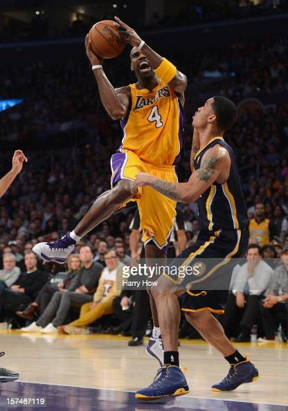 Antawn Jamison of the Los Angeles Lakers attempts a layup in front of Gerald Green of the Indiana Pacers during a 7977 Pacer win at Staples Center on...