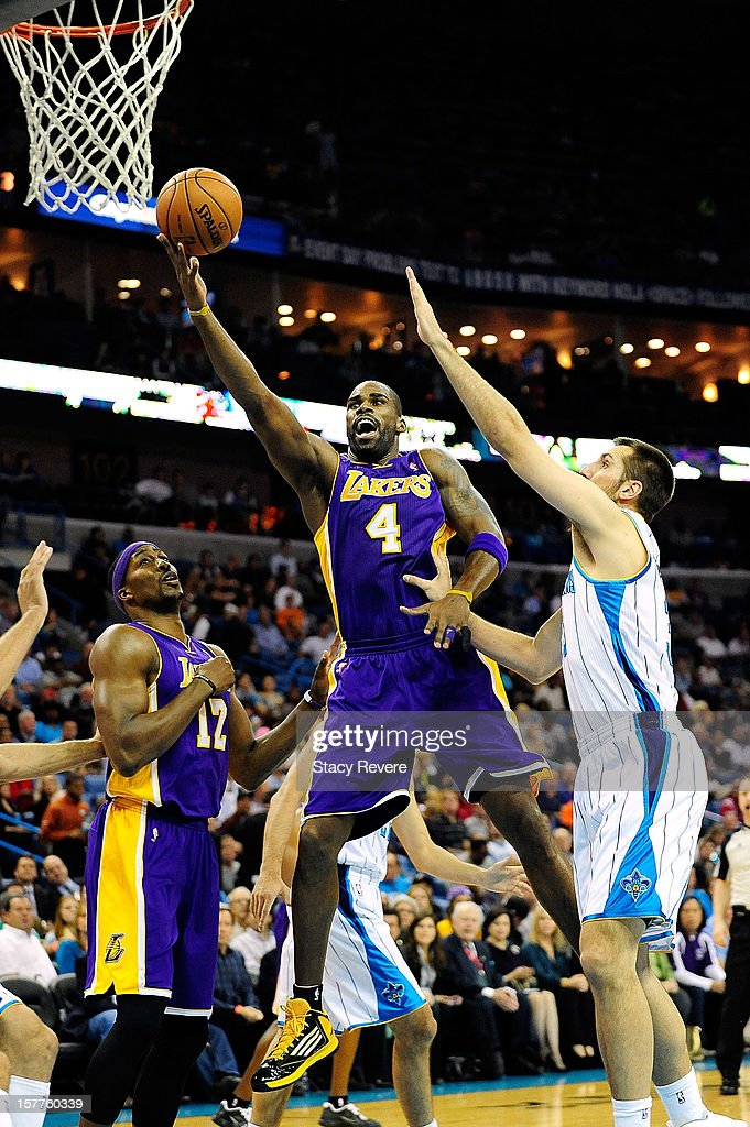 Antawn Jamison #4 of the Los Angeles Lakers drives past Greivis Vasquez #21 of the New Orleans Hornets at New Orleans Arena on December 5, 2012 in New Orleans, Louisiana.