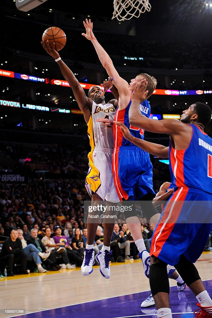 <a gi-track='captionPersonalityLinkClicked' href=/galleries/search?phrase=Antawn+Jamison&family=editorial&specificpeople=201670 ng-click='$event.stopPropagation()'>Antawn Jamison</a> #4 of the Los Angeles Lakers goes to the basket against <a gi-track='captionPersonalityLinkClicked' href=/galleries/search?phrase=Kyle+Singler&family=editorial&specificpeople=4216029 ng-click='$event.stopPropagation()'>Kyle Singler</a> #25 of the Detroit Pistons at Staples Center on November 4, 2012 in Los Angeles, California.