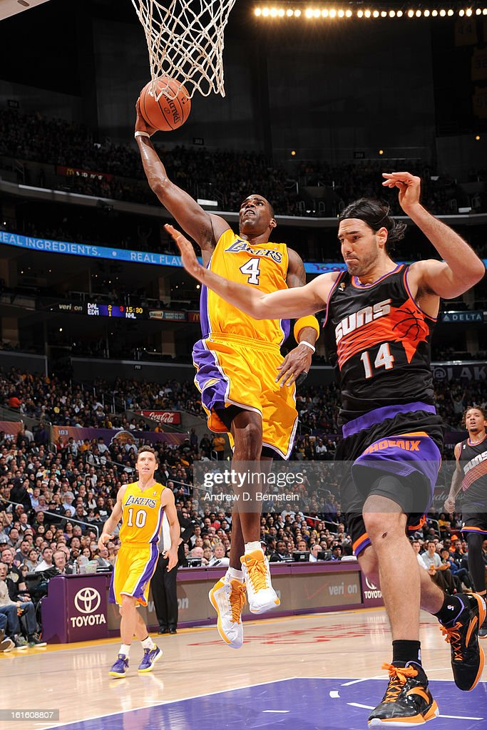Antawn Jamison #4 of the Los Angeles Lakers rises for a dunk against Luis Scola #14 of the Phoenix Suns at Staples Center on February 12, 2013 in Los Angeles, California.