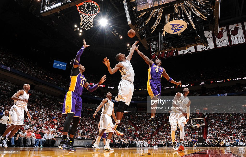 Antawn Jamison #4 of the Los Angeles Lakers sends the ball over Chris Bosh #1 of the Miami Heat during a game between the Los Angeles Lakers and the Miami Heat on February 10, 2013 at American Airlines Arena in Miami, Florida.
