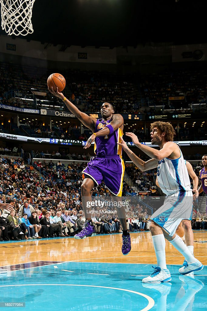 Antawn Jamison #4 of the Los Angeles Lakers shoots a layup against Robin Lopez #15 of the New Orleans Hornets on March 6, 2013 at the New Orleans Arena in New Orleans, Louisiana.