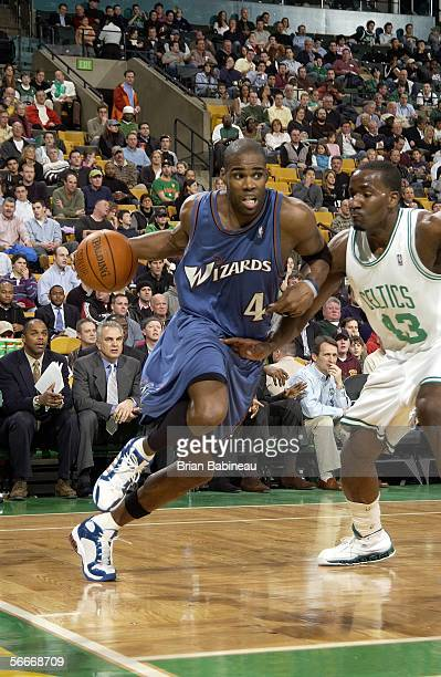 Antawn Jamison of the Washington Wizards drives against Kendrick Perkins of the Boston Celtics on January 25 2006 at the TD Banknorth Garden in...