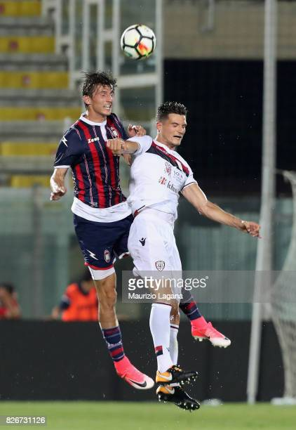 Ante Budimir of Crotone competes for the ball in air with Marco Andreolli of Cagliari during the PreSeason Friendly match between FC Crotone and...