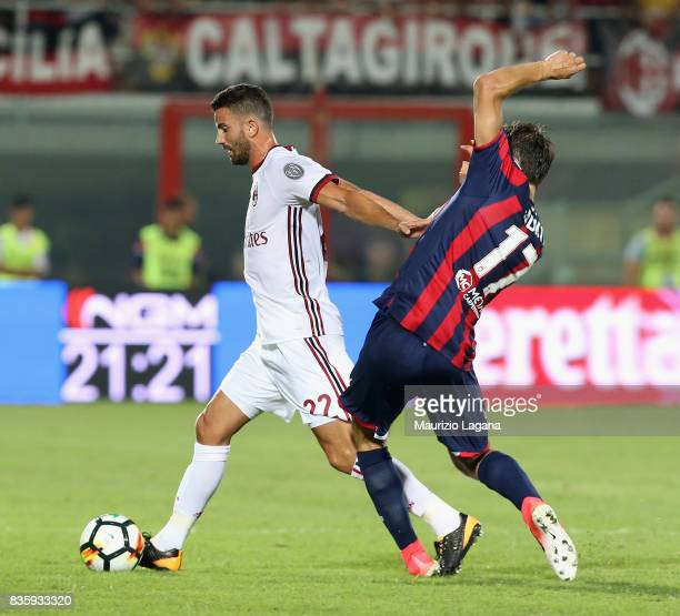 Ante Budimir of Crotone competes for the ball with Mateo Musacchio of Milan during the Serie A match between FC Crotone and AC Milan on August 20...