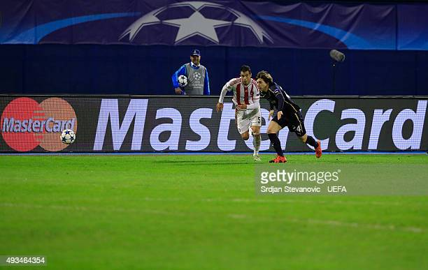 ZAGREB CROATIA OCTOBER 20 Ante Coric of Dinamo Zagreb in action against Luka Milivojevic of Olympiacos FC during the UEFA Champions League Group F...