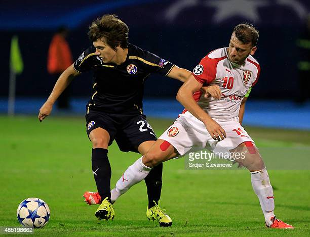 ZAGREB CROATIA AUGUST 25 Ante Coric of Dinamo Zagreb is challenged by Bledi Shkembi of KF Skenderbeu during the UEFA Champions League Qualifying...